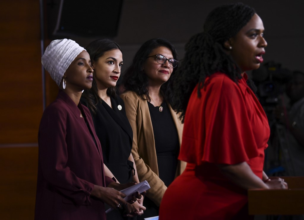 US representatives Ilhan Omar, Alexandria Ocasio-Cortez, Rashida Tlaib and Ayanna Pressley hold a news conference in Washington on 15 July (AFP)